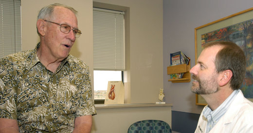 Michael Munger MD consults with a patient at his office in Overland Park photo courtesy AAFP