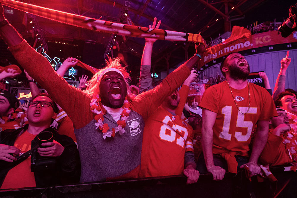Chiefs fans at KC Live! in downtown Kansas City go crazy over Patrick Mahomes' touchdown in the first quarter of the Super Bowl. (Photo by Julie Denesha)