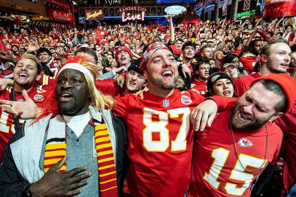 """The large crowd at KC Live! sings along to """"We Are The Champions"""" after the Chiefs' Super Bowl victory. (Photo by Julie Denesha, KCUR)"""
