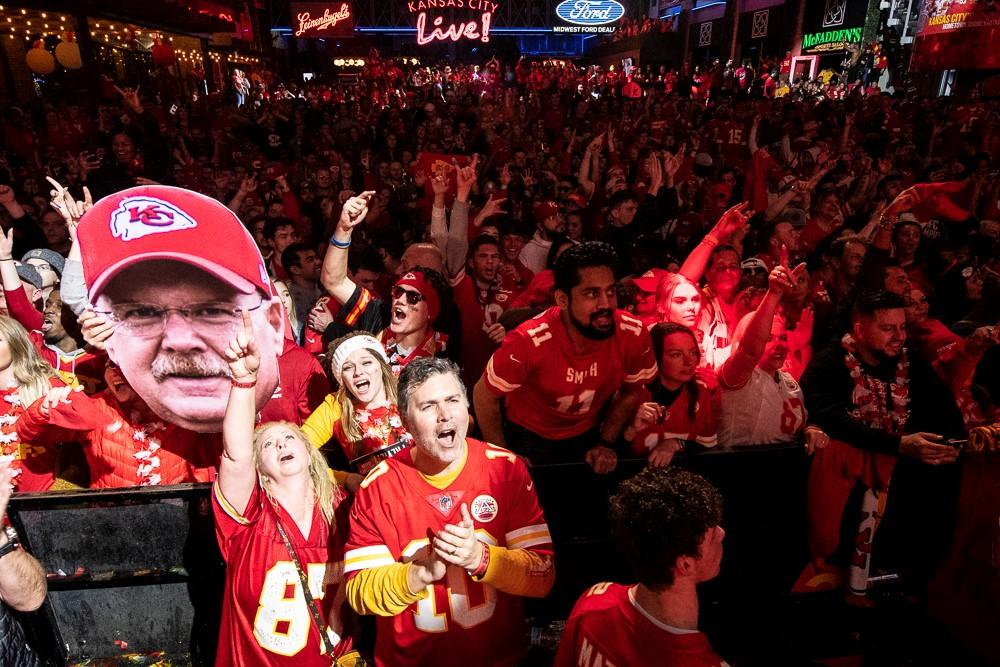 A giant Andy Reid head looms above the crowd at KC Live! on Sunday night as they celebrated the Chiefs' win over the 49ers. (Photo by Julie Denesha, KCUR)