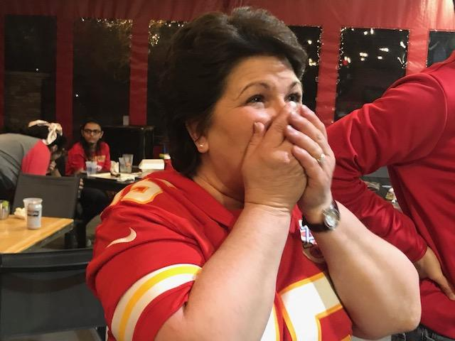 """Diane Muth of Overland Park watches as the Chiefs win the Super Bowl. """"It's nice to have people you don't normally see in the Super Bowl there, kind of like the little guy above all odds."""" (Photo by Laura Ziegler, KCUR)"""