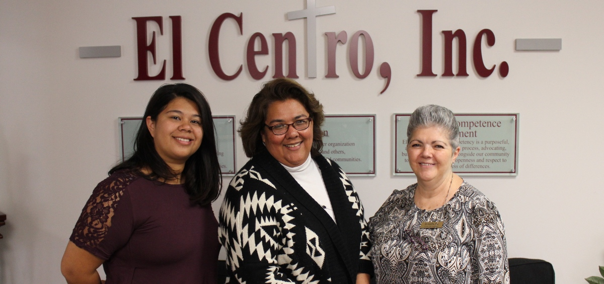 From left to right, Nubia Estefes, Irene Caudillo, and Cielo Fernandez at El Centro, which provides services targeted at the Latino community in Wyandotte County. (Photo by Stephen Koranda)