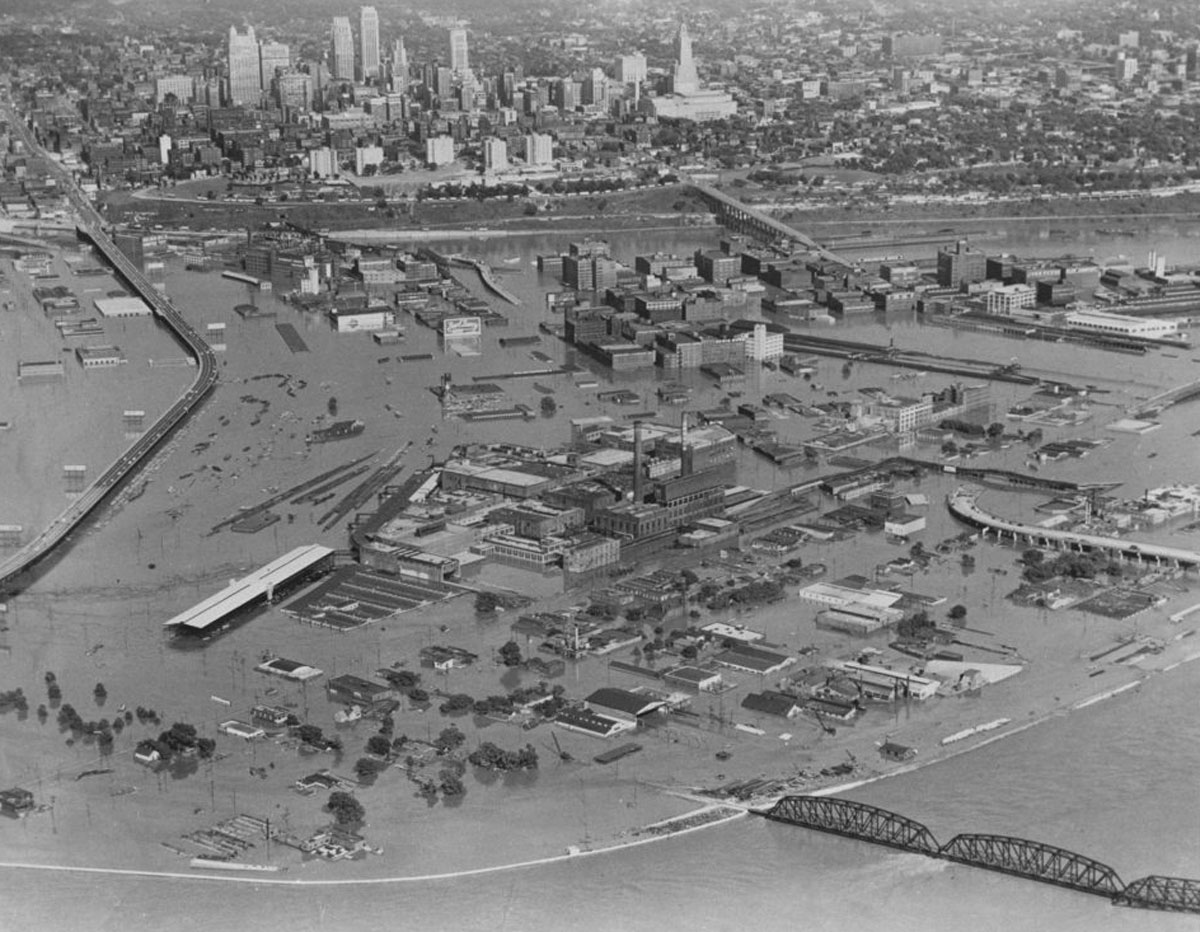The 1951 flood waters in the industrial district of Kansas City, Kansas. In the background are buildings in Kansas City, Missouri. (Photo Courtesy of Kansas Historical Society / kansasmemory.org)