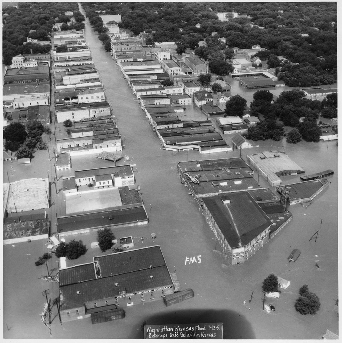 An aerial view showing flooding along Poyntz Avenue in downtown Manhattan, Kansas. Date: July 13, 1951 (Photo Courtesy of Kansas Historical Society / kansasmemory.org)