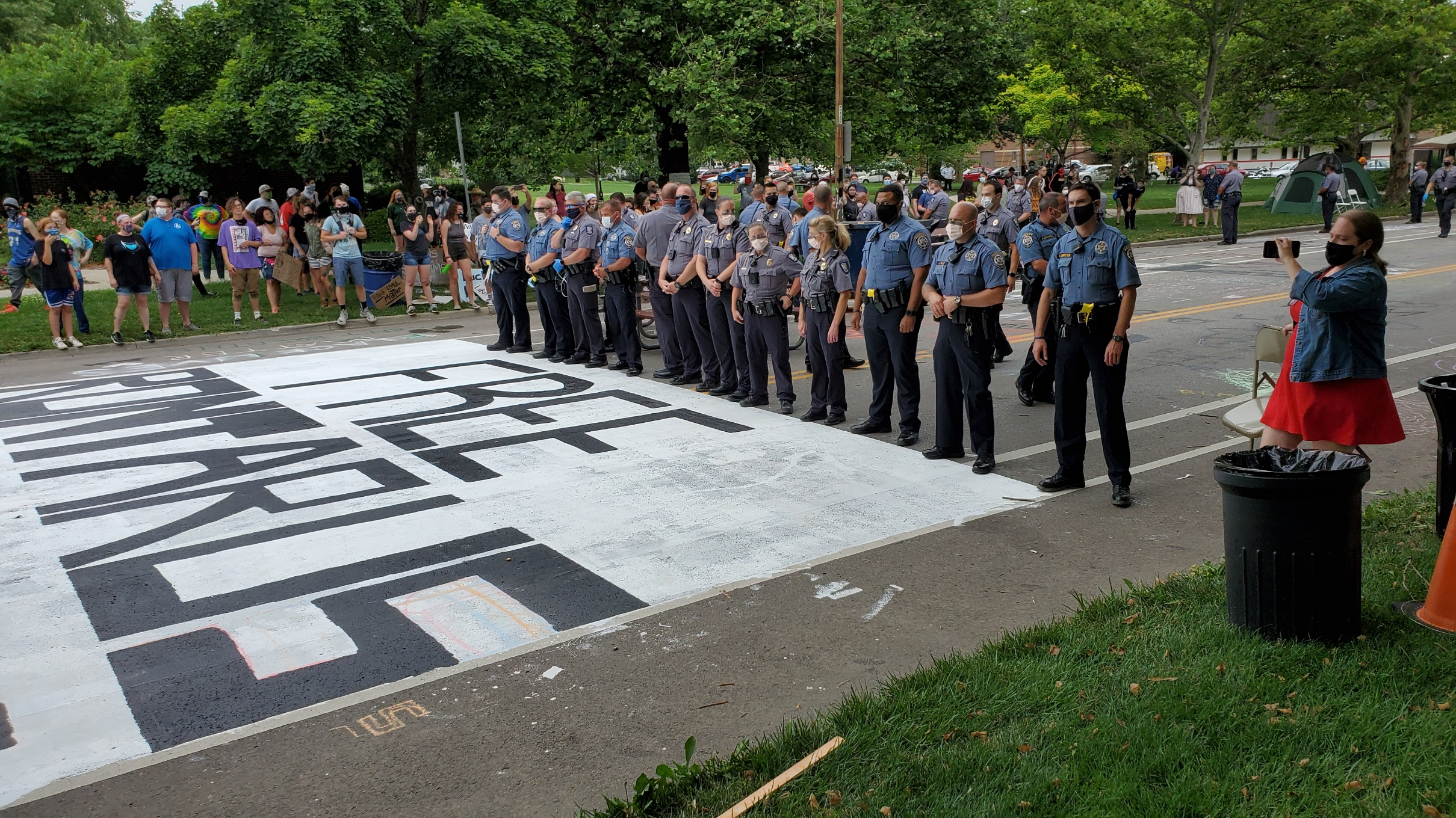 Police stand in the street after clearing away protesters Monday afternoon. (Photo by Stephen Koranda)