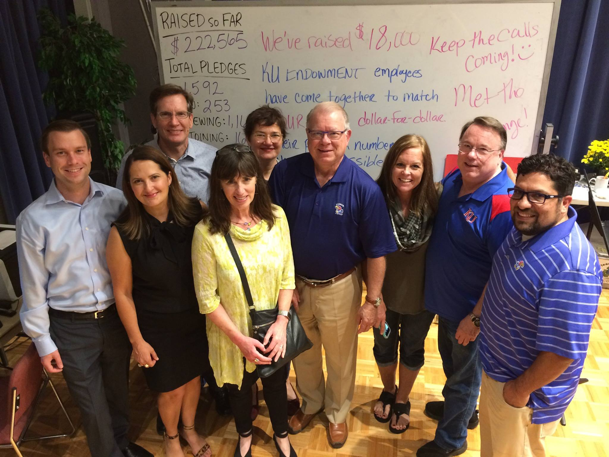 Hamilton (second from left) still helps out during KPR's semi-annual membership drives, joining a team of KU Endowment volunteers.