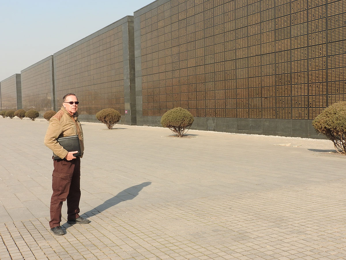 Professor and KPR Commentator John Richard Schrock standing outside the Tangshan Earthquake Memorial and Museum.