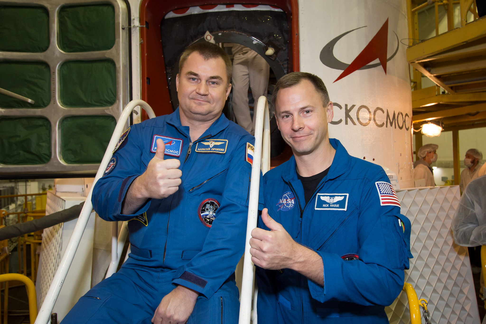 At the Baikonur Cosmodrome in Kazakhstan, Expedition 57 crewmembers Alexey Ovchinin of Roscosmos (left) and Nick Hague of NASA (right) pose for pictures Oct. 6 in front of the Soyuz MS-10 spacecraft. (Credit: NASA/Victor Zelentsov)