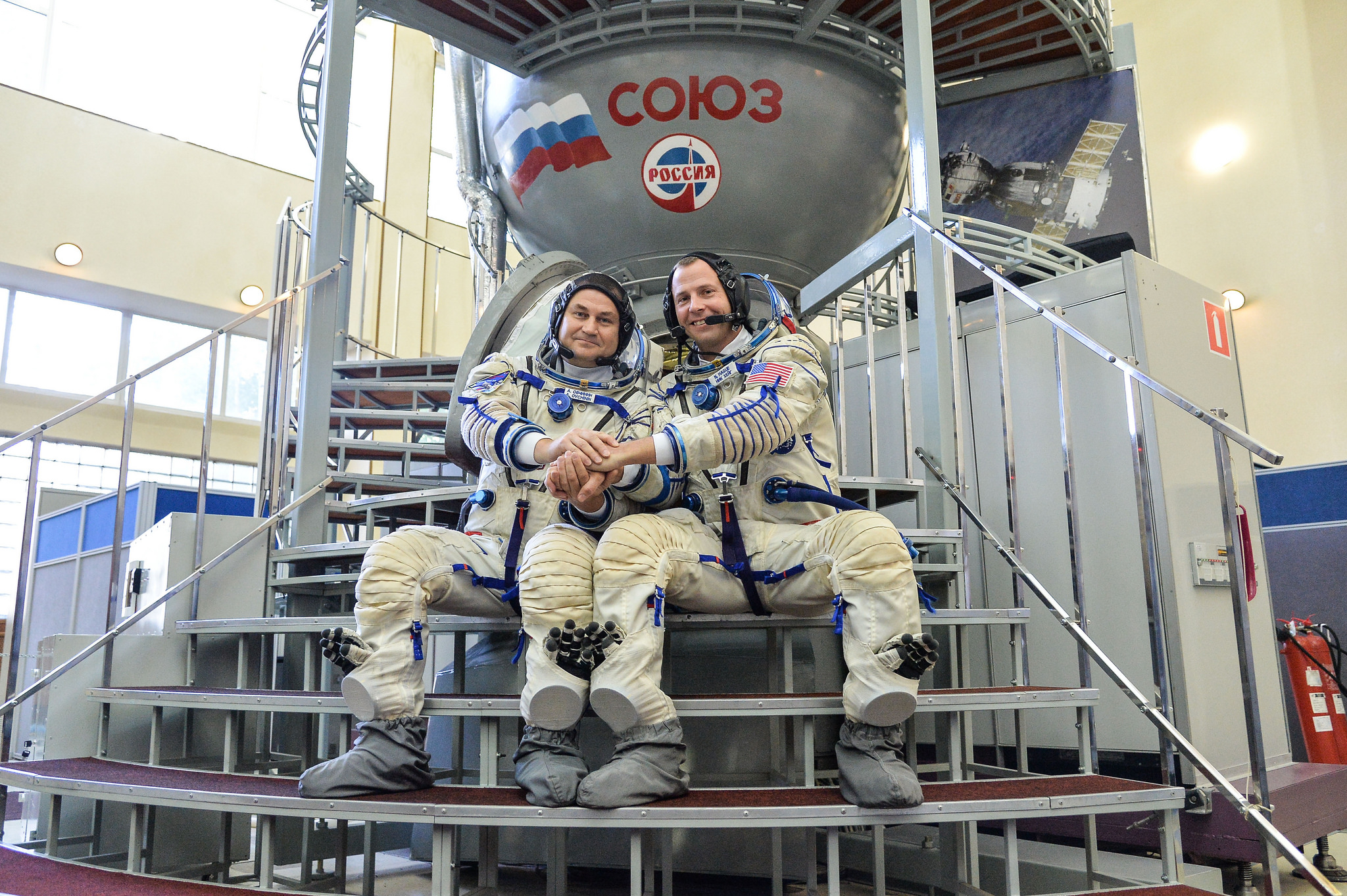At the Gagarin Cosmonaut Training Center in Star City, Russia, Expedition 57 crew members Alexey Ovchinin of Roscosmos (left) and Nick Hague of NASA (right) pose for pictures Sept. 14 during their Soyuz qualification exam activities. (Credit: NASA/Sarah Volkman)