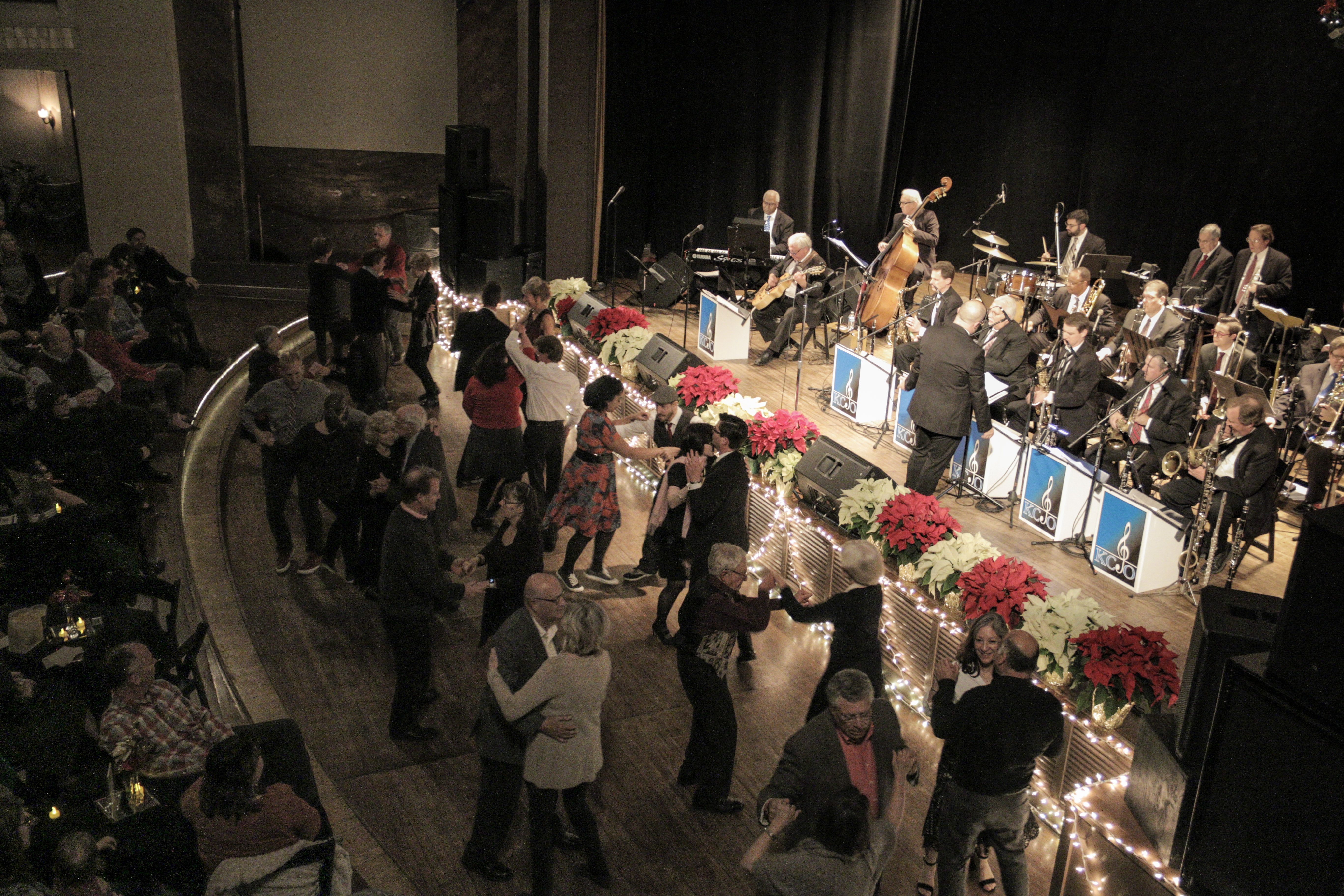 The crowd hits the dance floor during a rousing big band tune from the Kansas City Jazz Orchestra.