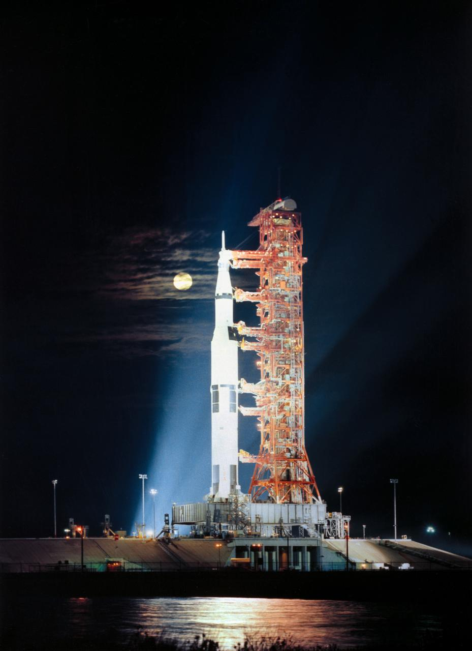Searchlights illuminate this nighttime scene at Pad A, Launch Complex 39, Kennedy Space Center, Florida, showing the Apollo 17 space vehicle during prelaunch preparations. Apollo 17, the final lunar landing mission in NASA's Apollo program, launched on the night of Dec. 6, 1972. (Photo via NASA)