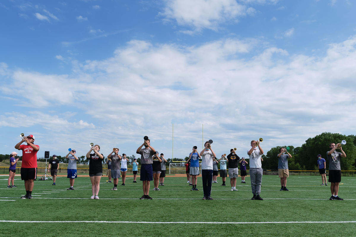 Valley Center High School band members stand at attention during camp. (Photo by Brian Grimmett, Kansas News Service)