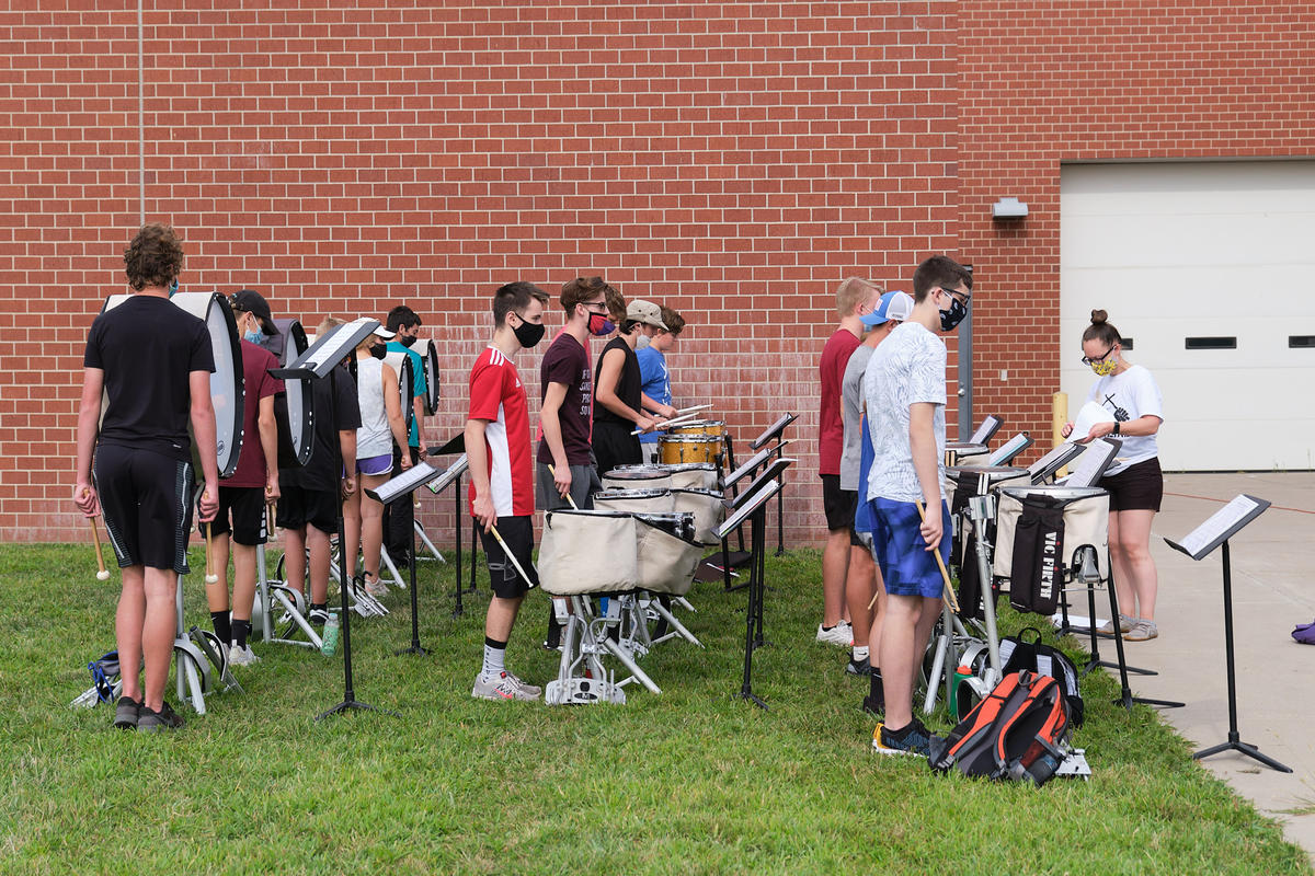 The Valley Center High School drumline waits for instructions during rehearsal. (Photo by Brian Grimmett, Kansas News Service)