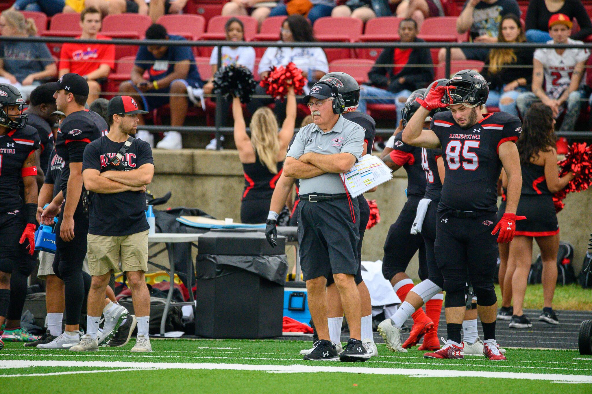 Coach Larry Wilcox stands on the sideline during the Ravens' 73-14 win over Clarke (Iowa) on September 21, 2019. (Photo by Jeremy Kaczor)