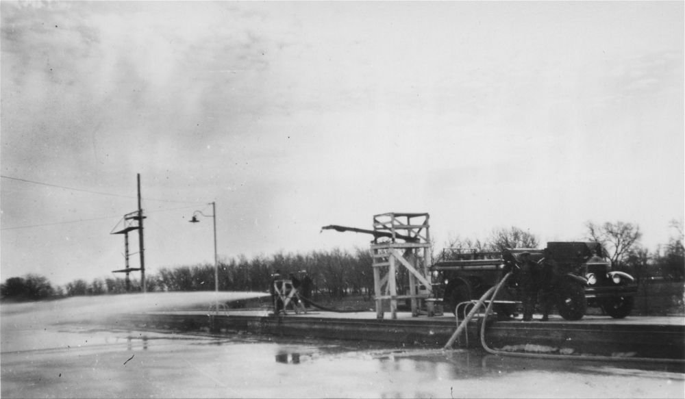 View of a concrete swimming pool in Garden City, Kansas. The pool was promoted as the largest swimming pool of this type. It was located in Finnup Park. Date: Between 1920 and 1930 (Photo Courtesy of Kansas Historical Society/kansasmemory.org)