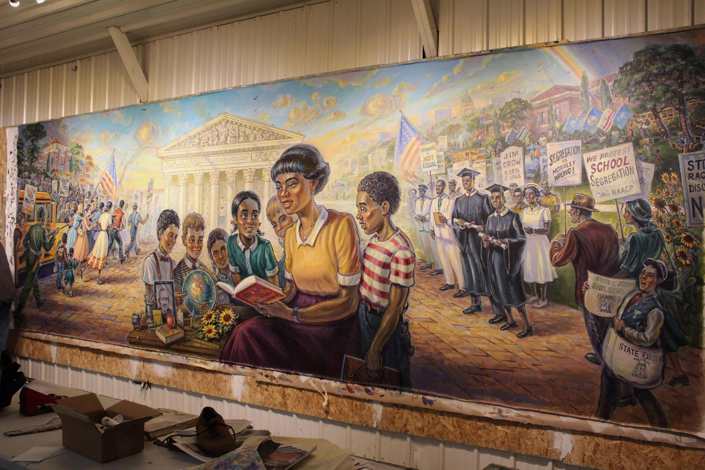 The Brown v. Board mural stands nearly complete in artist Michael Young's studio. The mural is now on display on the 3rd floor of the Kansas Capitol.  (Photo by Carla Eckels / KMUW)