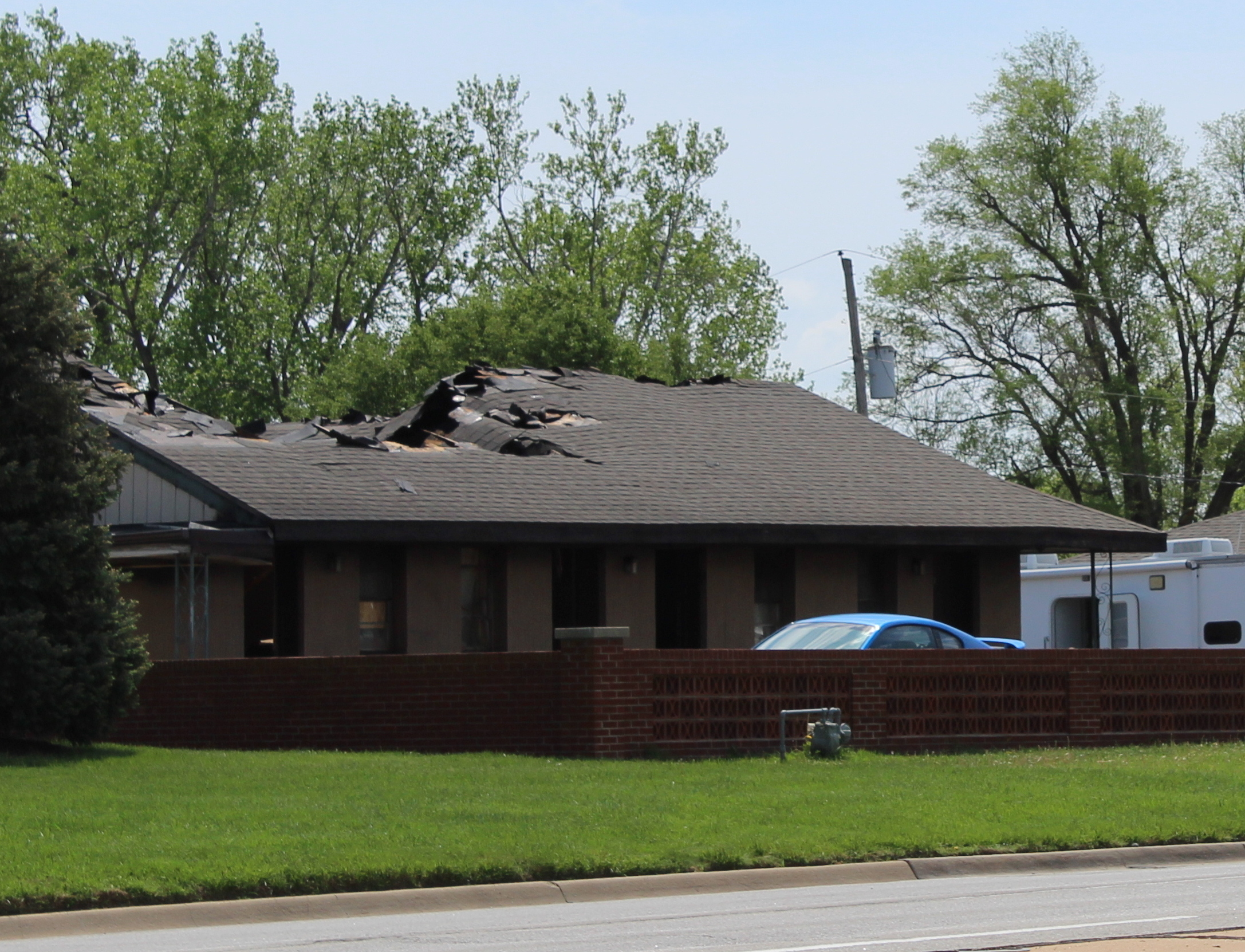 Collapsed roof in part of the burned out Country Club Motel in Topeka, scene of Saturday night's shootout and fire. (Photo by J. Schafer)