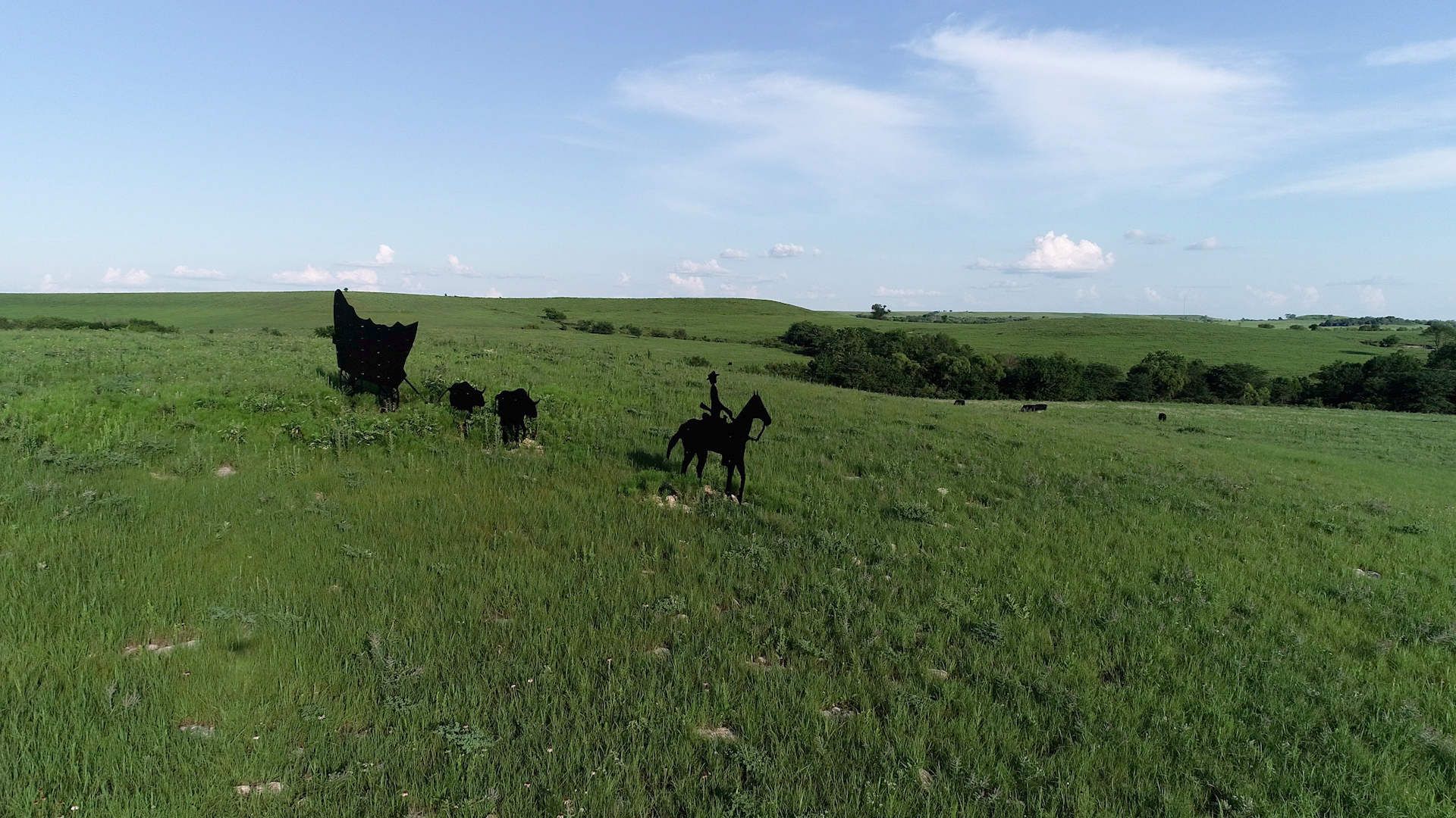 A metal silhouette of Santa Fe Trail travelers near Council Grove. (Photo by Dave Kendall)
