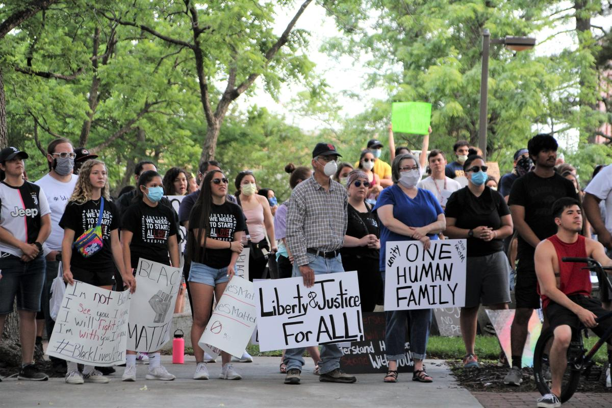 The crowd listens to speakers during the unity rally in Garden City. (Photo by Corinne Boyer, Kansas News Service)