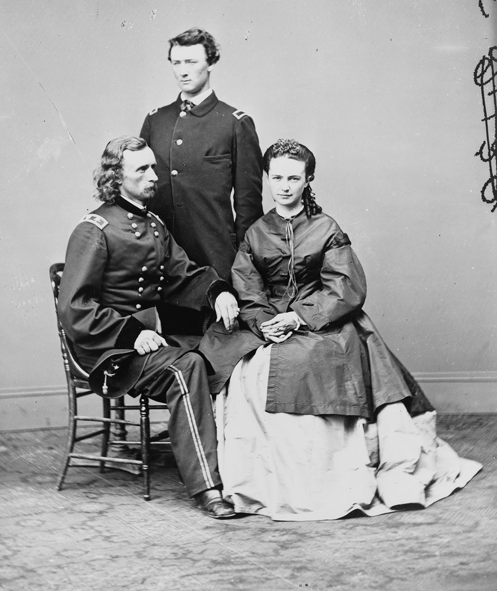 "George Armstrong Custer, in uniform, seated with his wife, Elizabeth ""Libbie"" Bacon Custer, and his brother, Thomas W. Custer, standing (photographed ca. January 3, 1865, printed later). (Courtesy of Library of Congress)"