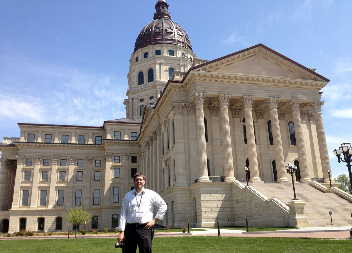 A recent photo of KPR's Statehouse Reporter, Stephen Koranda, outside the newly-remodeled Kansas Statehouse. (Photo by J. Schafer)