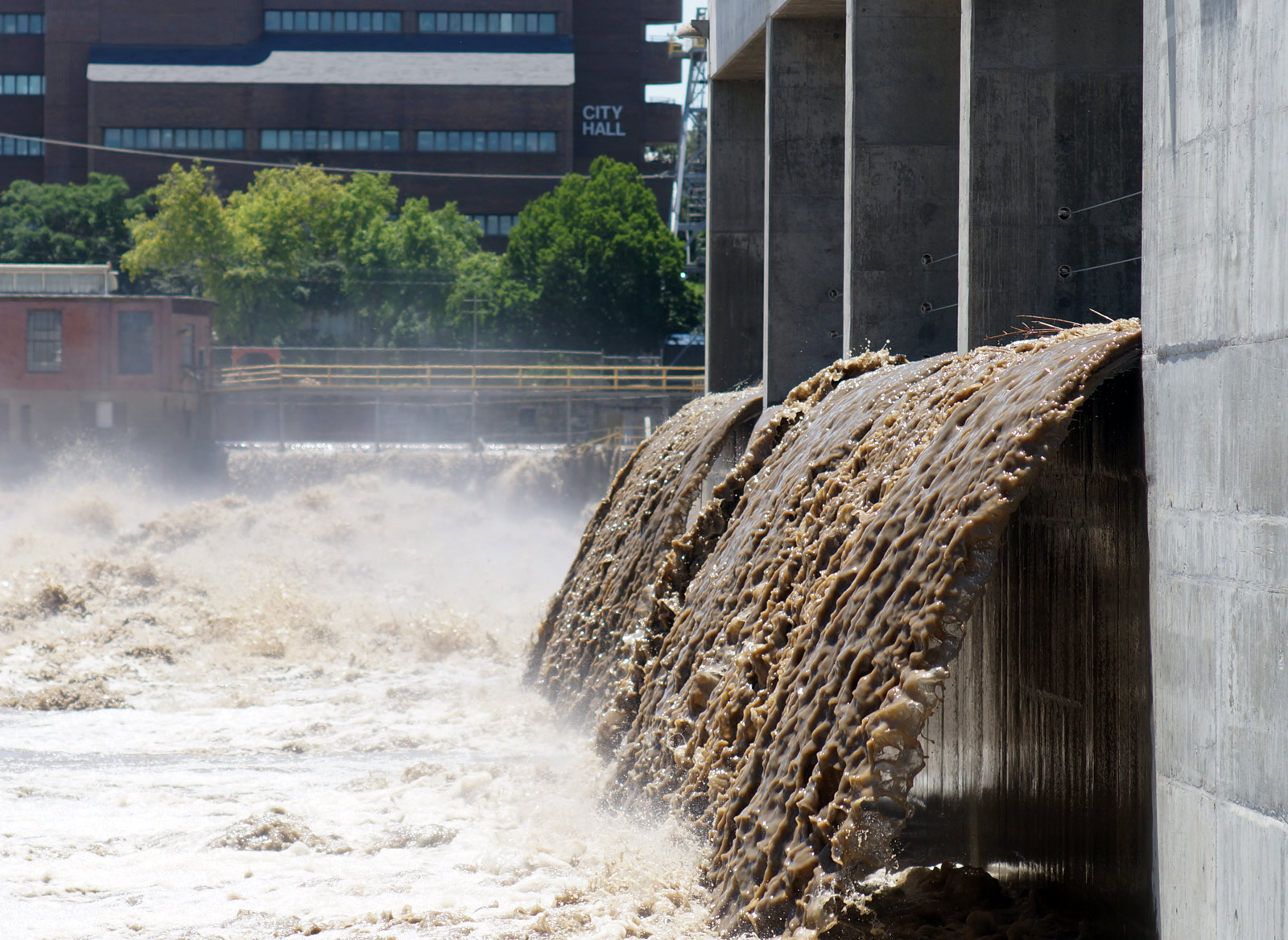The hydro-electric power plant in Lawrence is overflowing. Photo credit: Danny Mantyla.