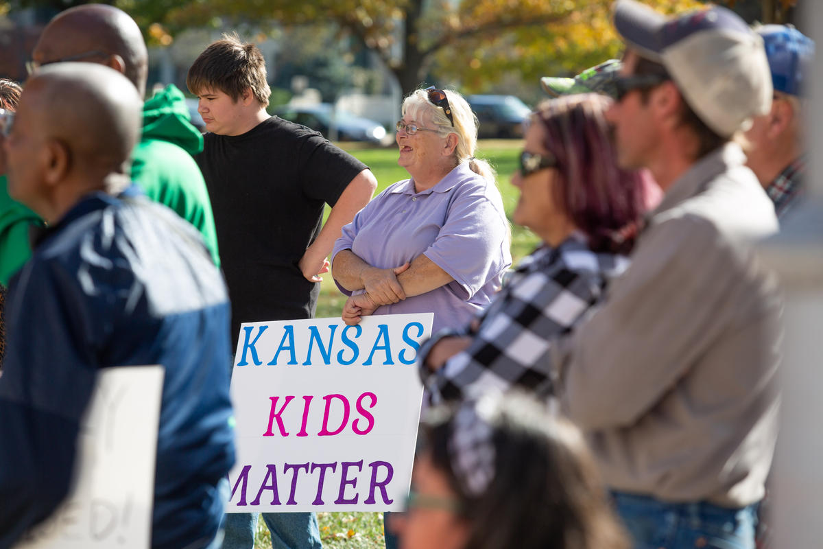 About two dozen people turned out to the Kansas statehouse on Saturday to protest the state's foster care system. (photo credit: Evert Nelson / Topeka Capital-Journal via Kansas News Service)