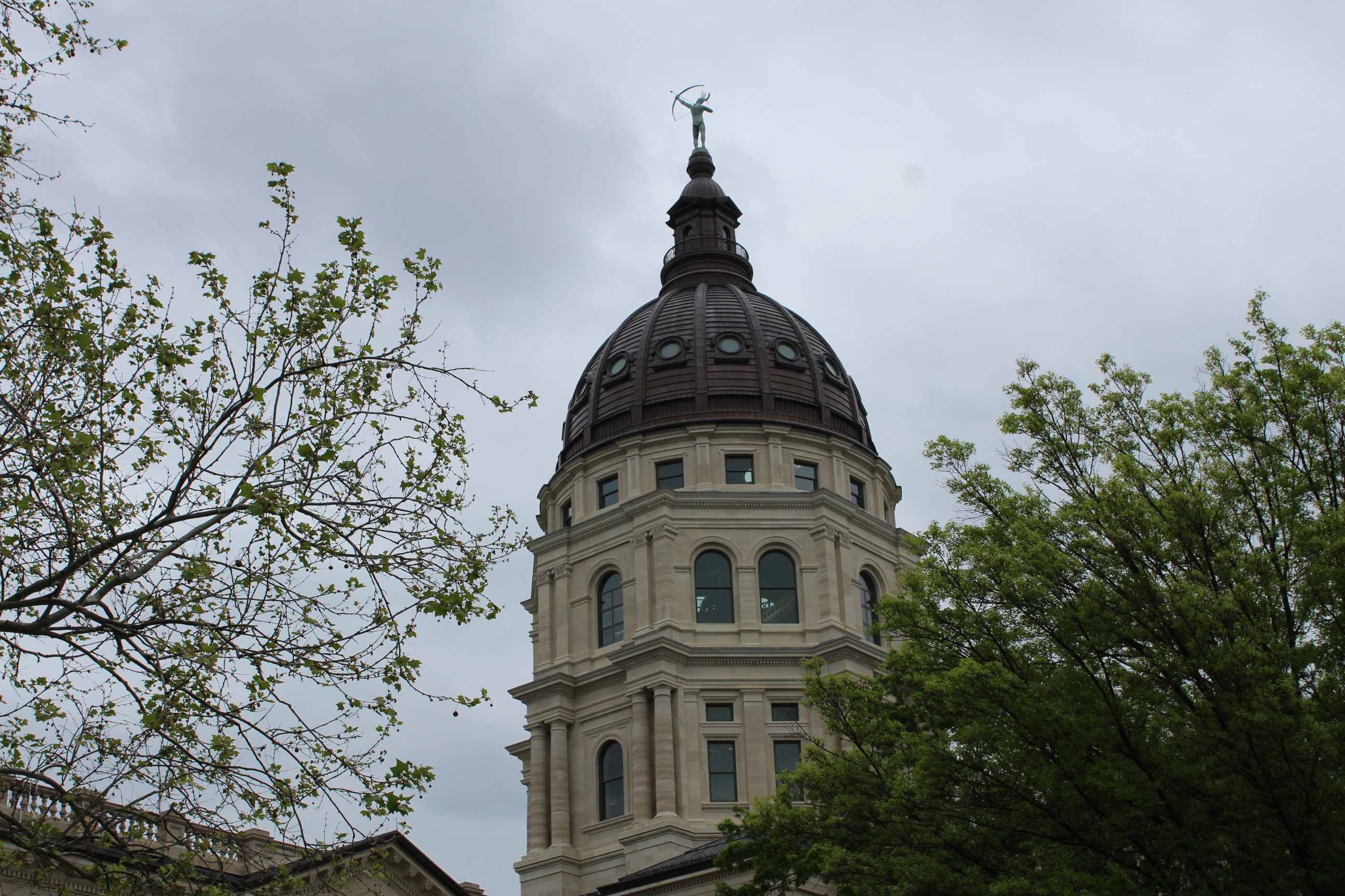 Kansas Statehouse dome towering above the trees (Photo by J. Schafer)