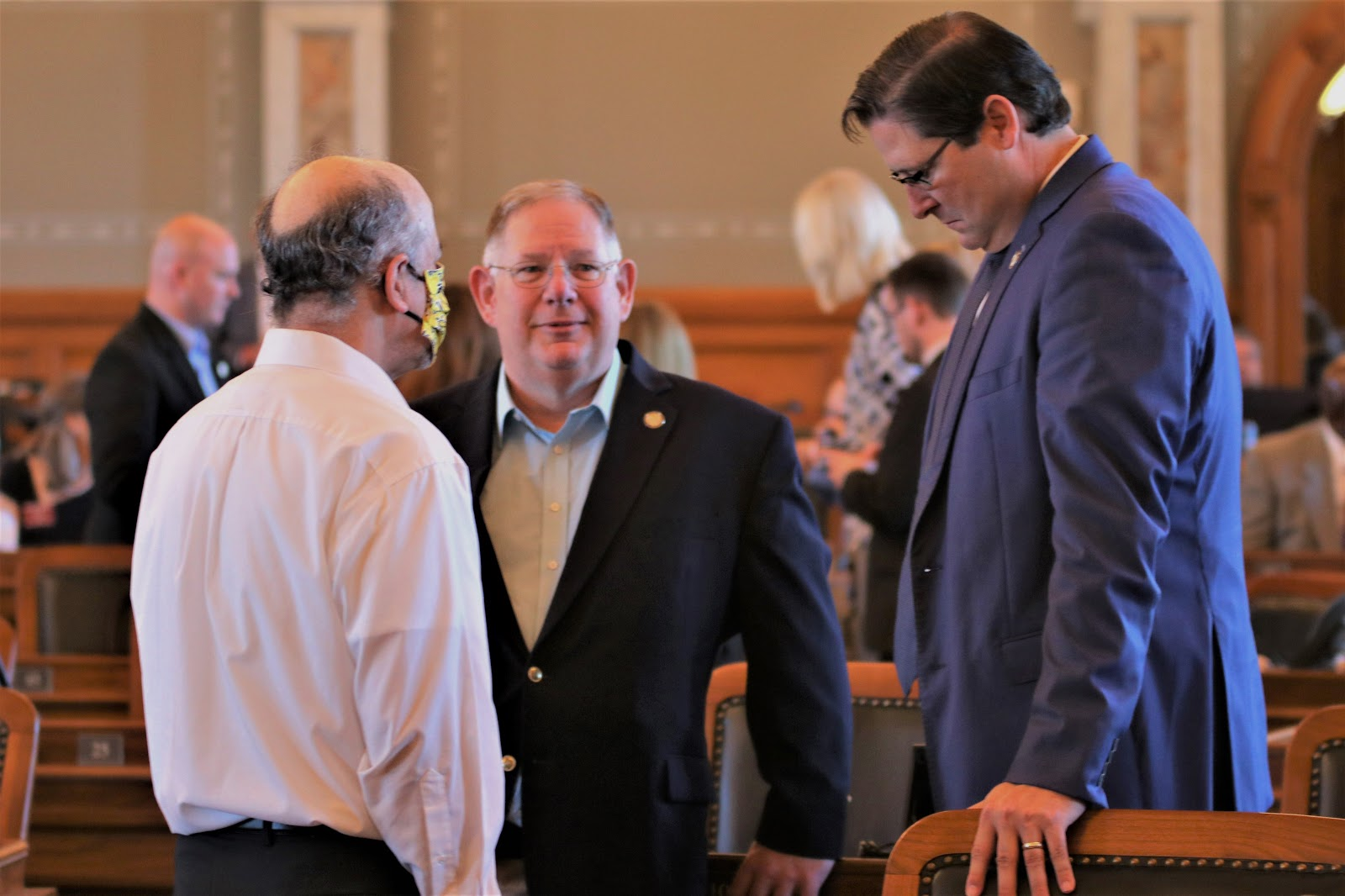 House Speaker Ron Ryckman (right) House Majority Leader Dan Hawkins (center) and House Minority Leader Tom Sawyer speaking earlier this month. All three are members of the panel that decides how to spend the federal aid. (Photo by Jim McLean, Kansas News Service)