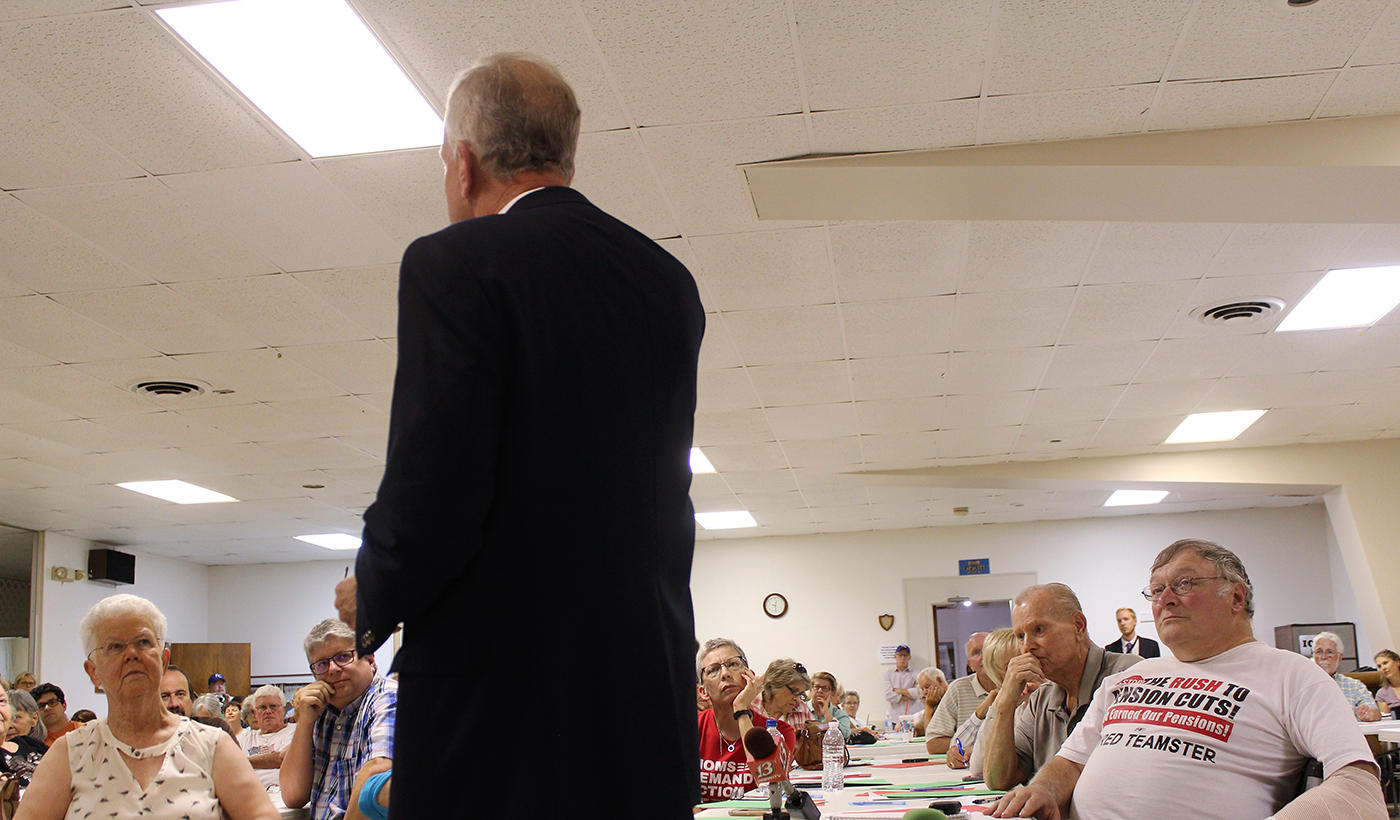 U.S. Sen. Jerry Moran speaks at a town hall meeting Friday in Topeka. News broke during the meeting that White House strategist Steve Bannon was leaving his job. (Photo by Jim McLean)