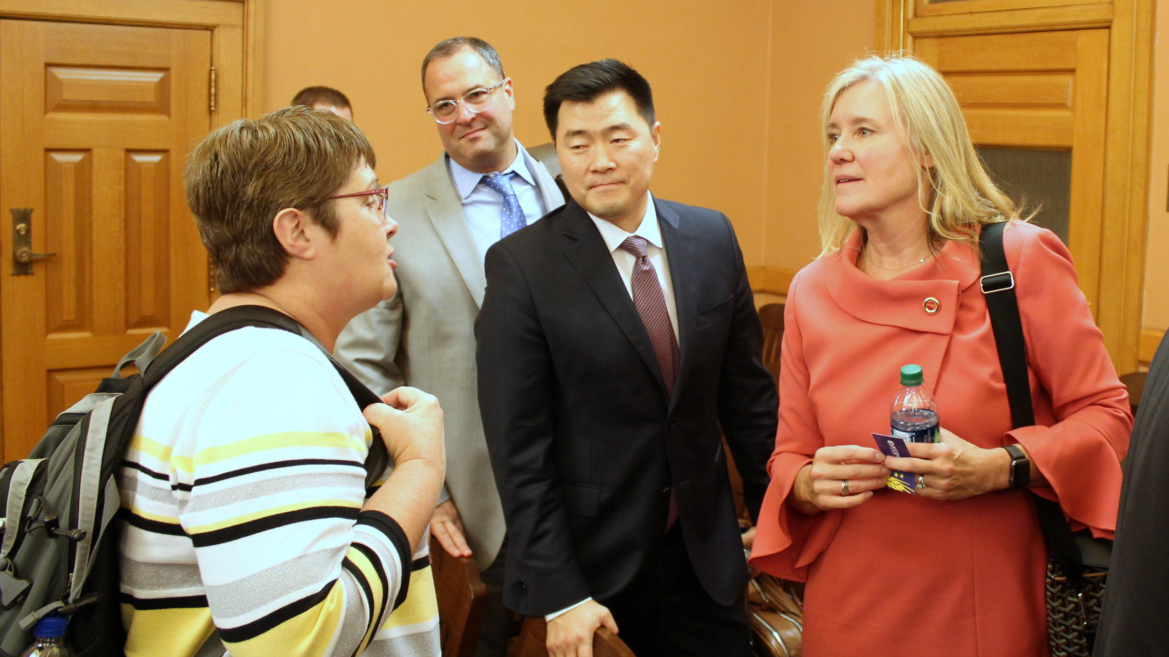 Aetna Medicaid CEO Randy Hyun (center) and Regional Vice President Deb Bacon (right) met with Kansas lawmakers in Topeka on Tuesday. (Photo by Stephen Koranda)