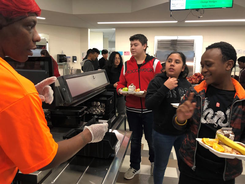 Students at Gloria Willis Middle School in Kansas City, Kansas, go through the lunch line. The pandemic has underscored the importance of the National School Lunch Program and other federal revenue streams for schools. (Photo by Elle Moxley, KCUR)