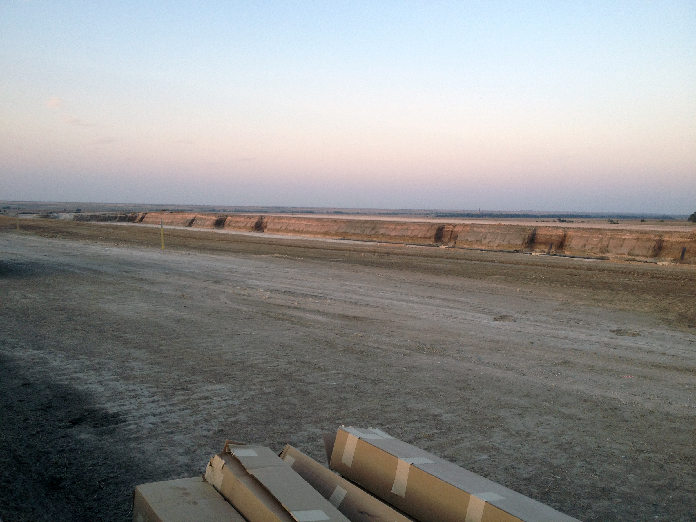 The first of three large hog waste pits under construction near the town of Pfeifer, southeast of Hays. (Photo by Bryan Thompson / Kansas News Service)