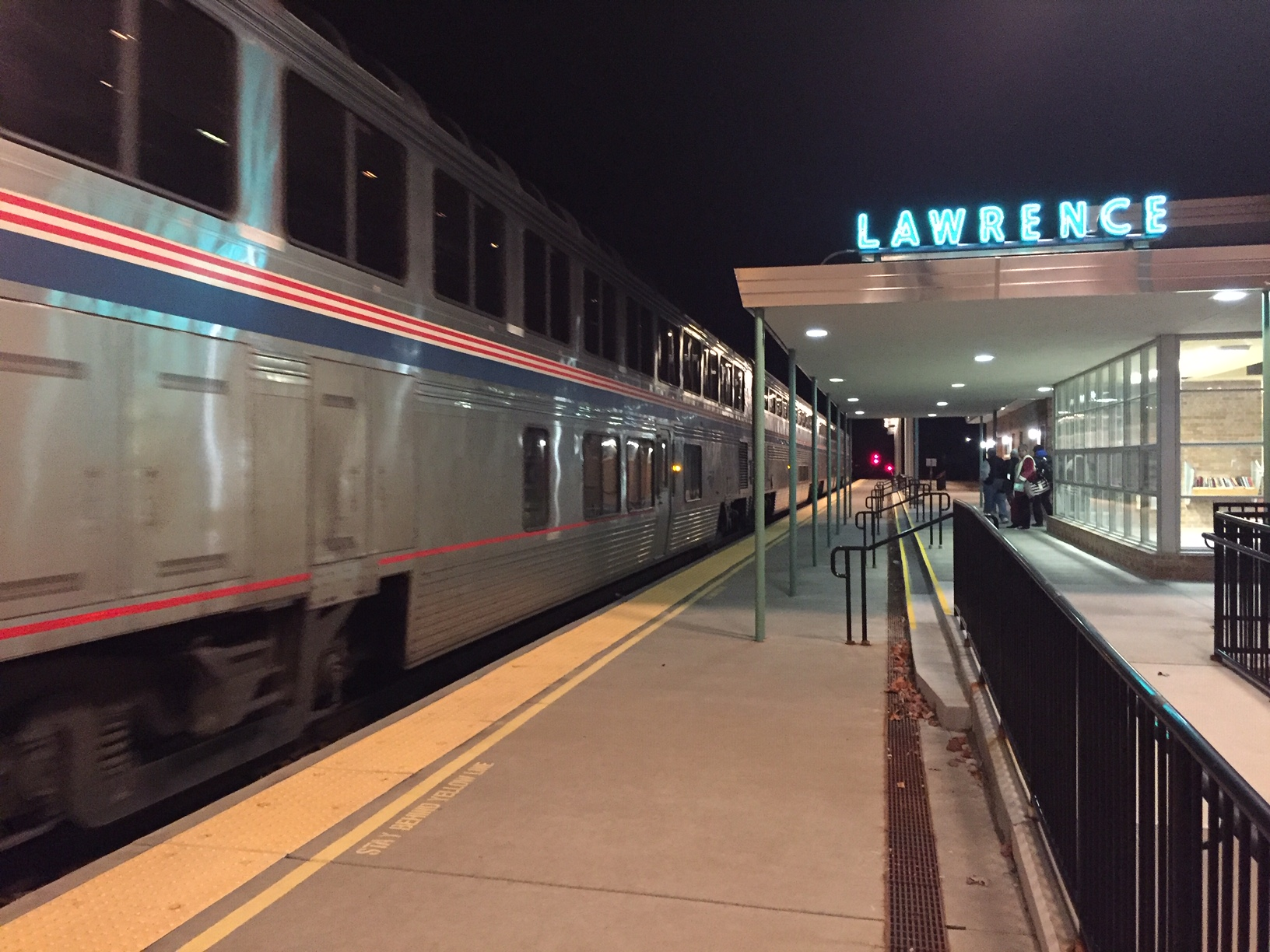 The westbound Southwest Chief, an Amtrak train, pulls into the depot in Lawrence, Kansas, just before midnight.  (Photo by J. Schafer)