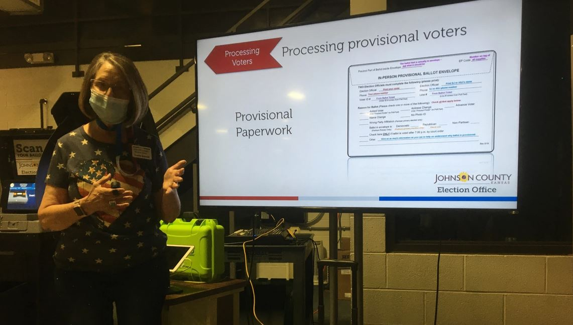 Connie Schmidt, Johnson County Election Commissioner, leads a training on July 11 in Olathe for poll workers who will be dealing with provisional ballots. (Photo by Peggy Lowe)