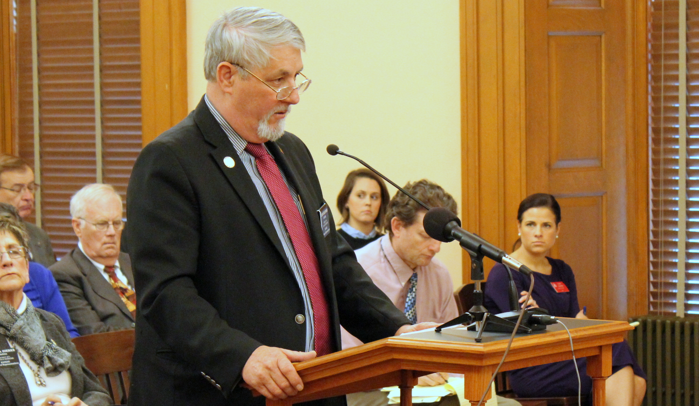 Rep. John Bradford speaking to a legislative committee. (Photo by Stephen Koranda)