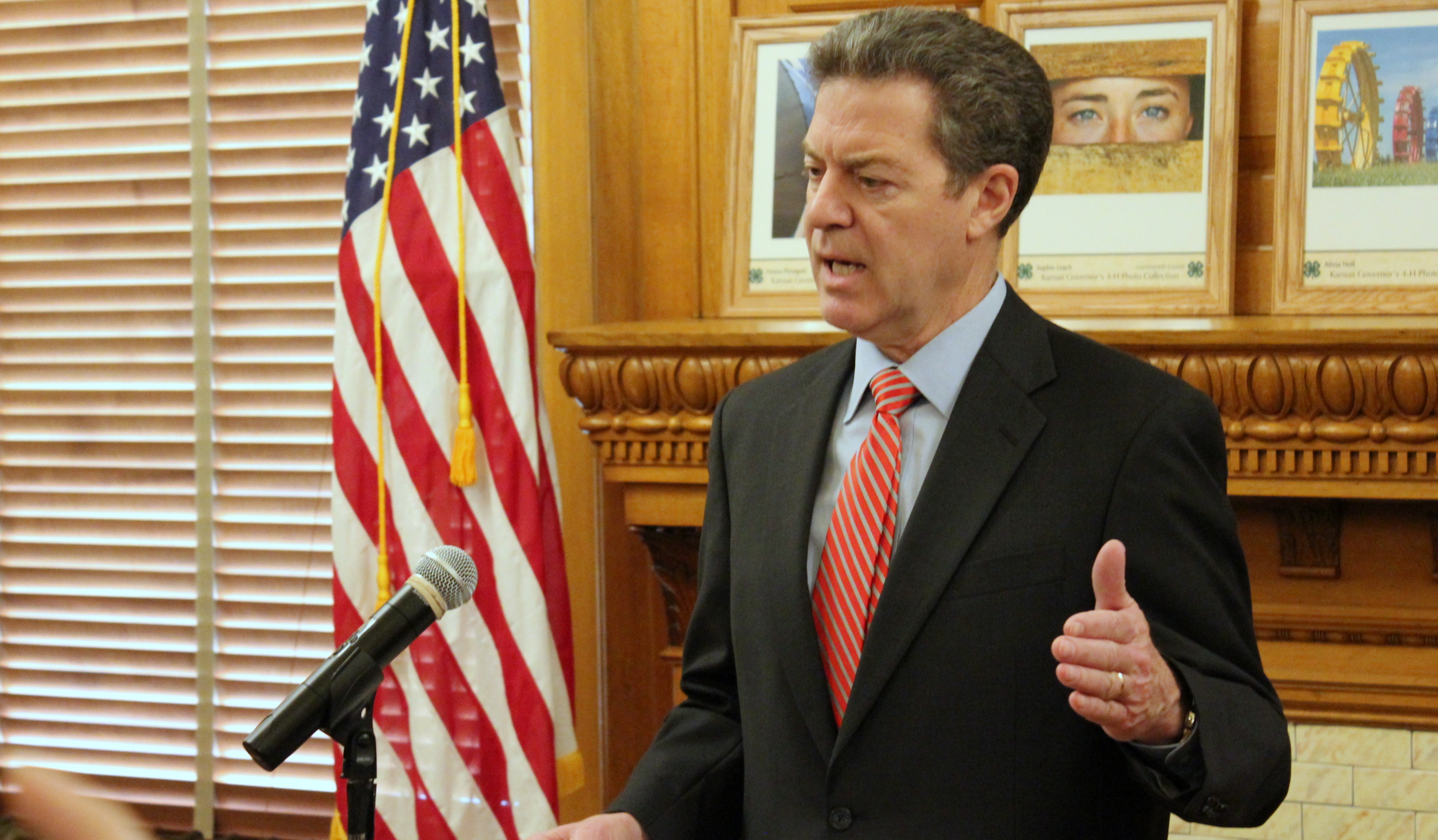 Governor Brownback speaking to reporters at the Statehouse Wednesday. (Photo by Stephen Koranda)