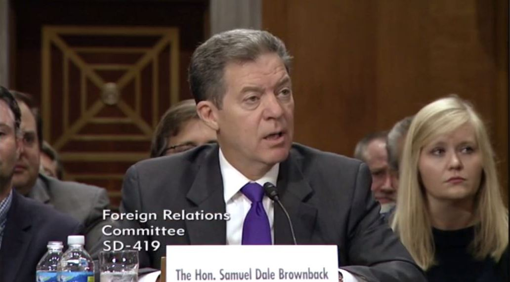 Governor Brownback speaking at the hearing.