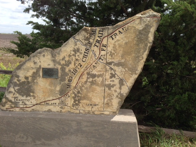 A stone marker signifies the spot where the Chisholm Trail and the Santa Fe Trail intersected in central Kansas. (Photo by Rex Buchanan)