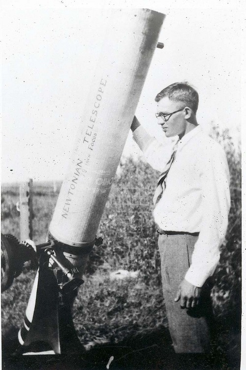 Discoverer of Pluto, Clyde Tombaugh, with a telescope he built by hand on his family's central Kansas farm.  (Photo courtesy of Kansasmemory.org.) Tombaugh located Pluto when he was just 24 years old, before he went to college.