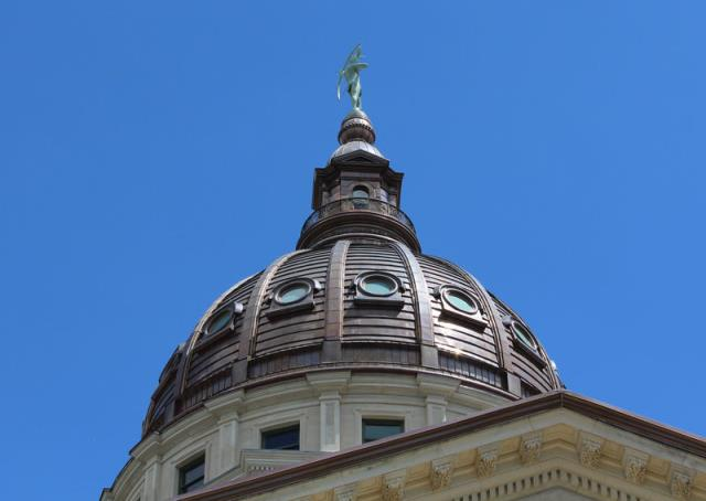 The Kansas House has given first-round approval to providing Medicaid to more low-income, non-elderly adults.