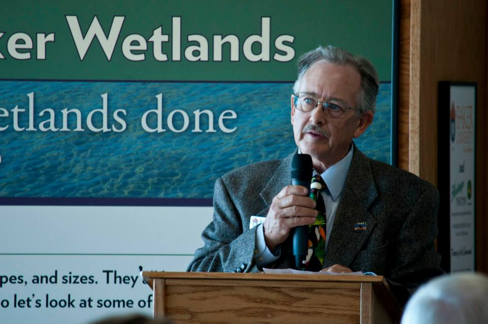Dr. Roger Boyd, professor emeritus of biology at Baker University and the education coordinator for the Baker University Wetlands Discovery Center, speaking at the center's dedication ceremony Wednesday. (Photo credit: Alex Skov, Baker University)