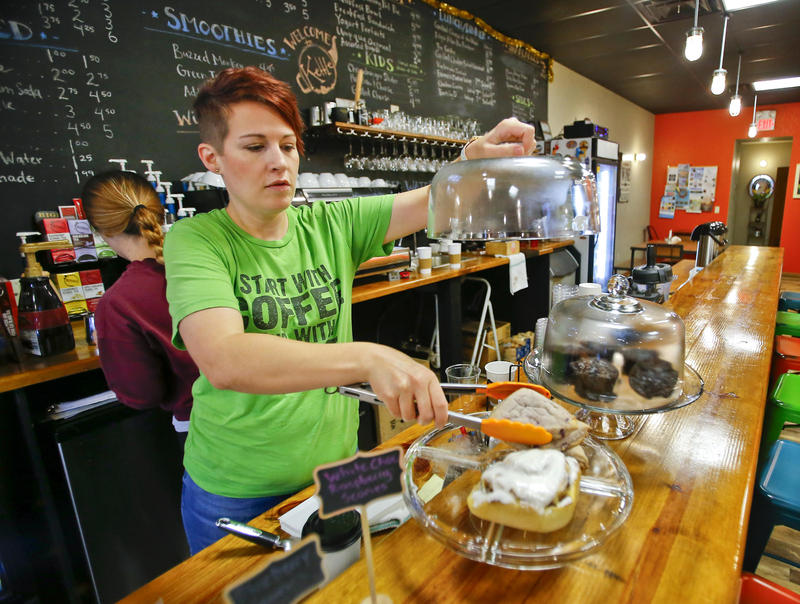 """Mandy Fincham and her husband run the Kettle in Beloit, Kansas. Some people think """"quality-of-life"""" initiatives like their cafe and wine bar can make a difference between small towns shrinking smartly or withering on the vine. (Photo by Chris Neal / Kansas News Service)"""