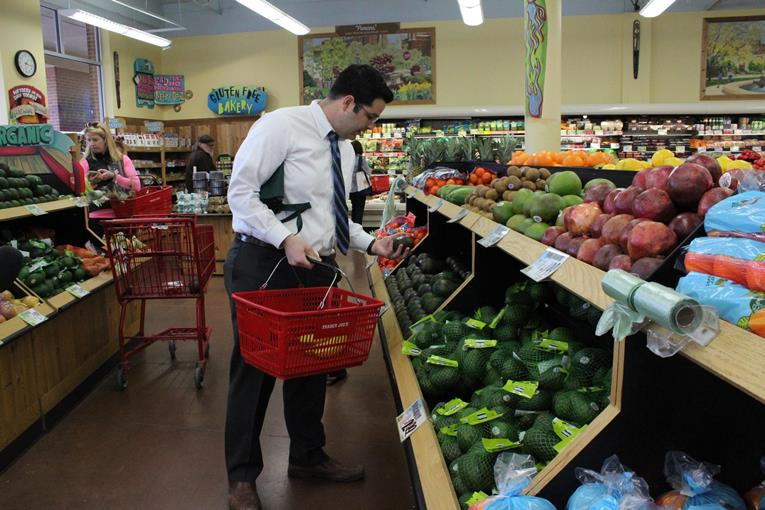 Mike Kelly lives in Kansas but shops for groceries in Missouri. (Photo: KMUW's Jordan Kirtley)
