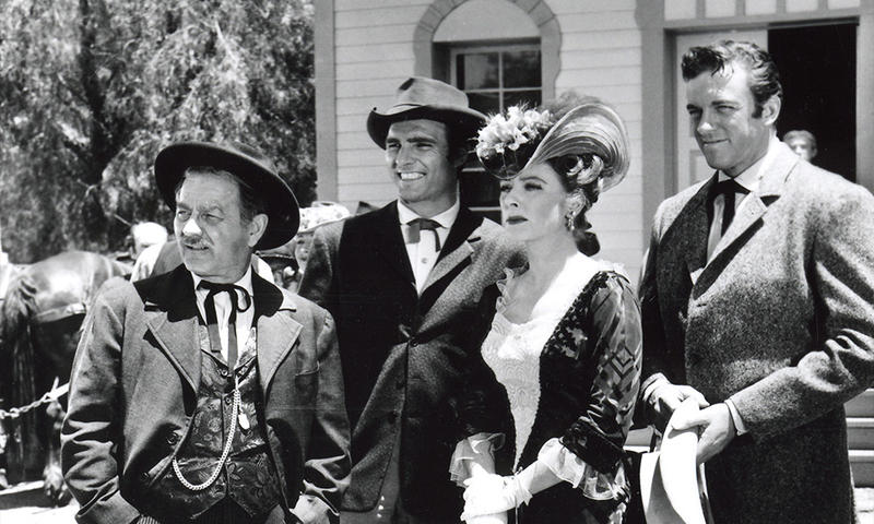 "In this still shot from TV's ""Gunsmoke"" series, Burrton, Kansas native Milburn Stone (L) played Doc, Dennis Weaver played Chester, Amanda Blake played Miss Kitty and James Arness (R) portrayed Matt Dillon.  (Photo Courtesy of Boot Hill Museum, Dodge City, Kan.)"