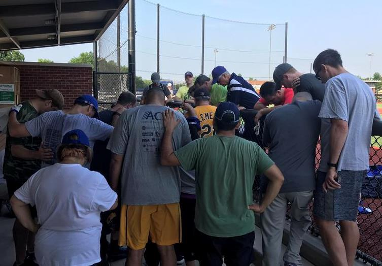 House Democrats pray for their colleagues at their own baseball practice in a photo tweeted by Representative Ruben J. Kihuen of Nevada.