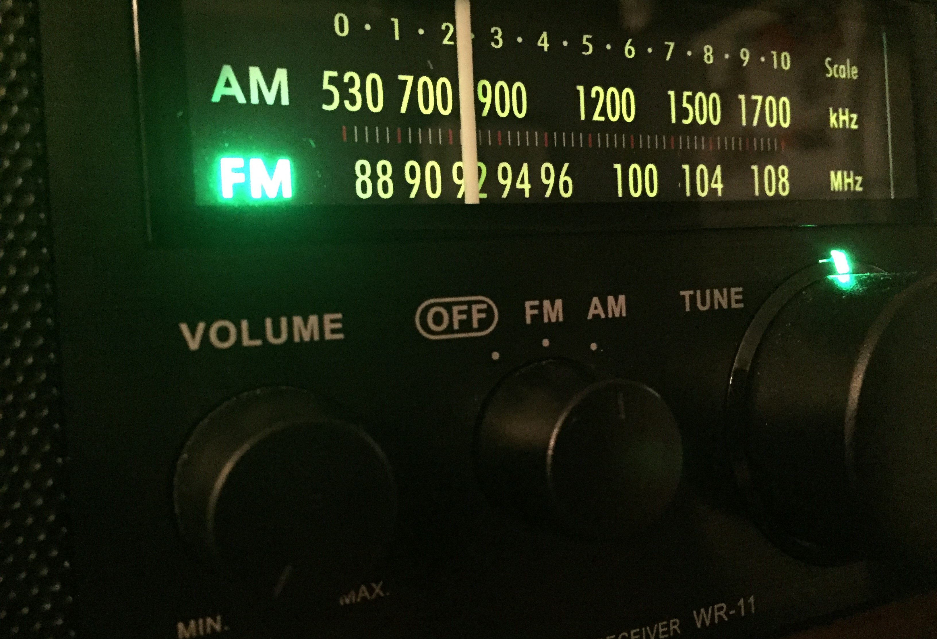 The green glow of radio. This is the illuminated dial of a modern-day Sangean radio.  (Photo by J. Schafer)