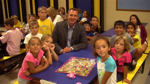 Wichita School District Superintendent John Allison (center) surrounded by elementary school students (photo credit: USD259.org)
