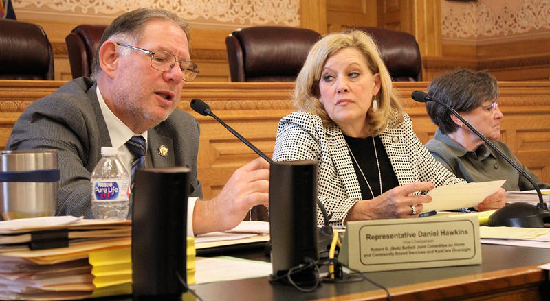 Representative Dan Hawkins, left, a Wichita Republican, and other GOP legislators on an oversight committee this week approved the Brownback administration's proposal to seek renewal of its privatized Medicaid program for five years.  (Photo by Jim McLean /Kansas News Service)