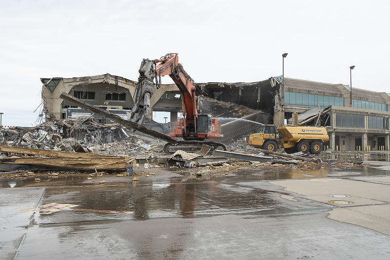 Large excavators lay waste to terminal A at Kansas City International Airport, June 26, 2019. (Photo by Julie Denesha / KCUR Radio)
